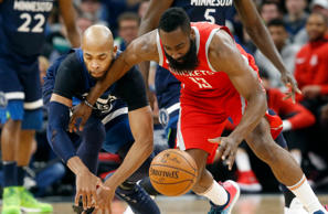Houston Rockets' James Harden, right, and Minnesota Timberwolves' Taj Gibson chase a loose ball during the first half of Game 4 in an NBA basketball first-round playoff series Monday, April 23, 2018, in Minneapolis. (AP Photo/Jim Mone)
