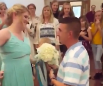 Bridesmaid catches bouquet and gets  her own surprise