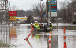 Employees of Louisville Gas & Electric make their way to River Road to turn off power to companies along the Ohio River after it flooded in Louisville, Kentucky, U.S., February 25, 2018.