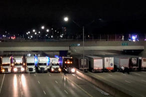 Semi trucks block a suicide attempt in Detroit early Tuesday morning on April 24, 2018.