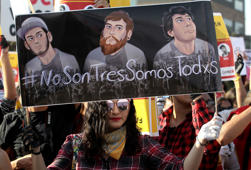 Students take part in a protest to demand the appearance of three missing film students alive, in Guadalajara, Jalisco state, Mexico, on March 24, 2018.  Three film students from the University of Audiovisual Media of Jalisco state went missing last Monday. According to the denounce they were intercepted when they were returning from a shooting in the western locality of Tonala. / AFP PHOTO / ULISES RUIZ        (Photo credit should read ULISES RUIZ/AFP/Getty Images)