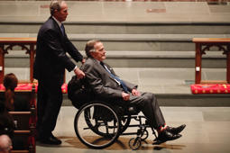 HOUSTON, TX - APRIL 21:  Former President George H.W. Bush, assisted by his son, former President George W. Bush, enter the church during the funeral for former First Lady Barbara Bush on April 21, 2018 in Houston, Texas. Bush, wife of former president George H. W. Bush and mother of former president George W. Bush, died at her home in Houston on April 17 at the age of 92.  (Photo by Brett Coomer - Pool/Getty Images)