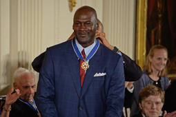 Michael Jordan wearing a suit and tie: Michael Jordan's Business Empire Has Him Flying, Even In Retirement