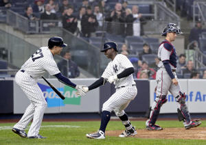 New York Yankees' Didi Gregorius, right, celebrates with Giancarlo Stanton after hitting a solo home run against the Minnesota Twins during the third inning of a baseball game, Wednesday, April 25, 2018, in New York. (AP Photo/Julie Jacobson)