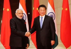 Indian Prime Minister Narendra Modi shakes hands with Chinese President Xi Jinping