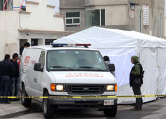 Police and forensic personnel work on a crime scene where attackers burst during a party and murdered 11 people in Tizayuca, Hidalgo state, Mexico, on July 13, 2017. Gunmen burst into a home in central Mexico during a party and killed 11 people, authorities and media reports said Thursday, the violence-plagued country's latest mass murder. Police found the gory scene when they responded to an emergency call received just after midnight in the city of Tizayuca, in the central state of Hidalgo, the state security service said in a statement.  / AFP PHOTO / ALDO FALCON        (Photo credit should read ALDO FALCON/AFP/Getty Images)