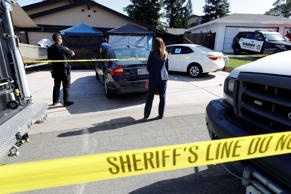 Sheriff's crime scene tape surrounds the house belonging to Joseph James Deangelo REUTERS/Fred Greaves