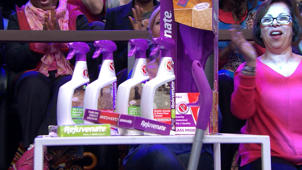a little girl posing for a picture: Megyn Kelly audience members receive cleaning products from Rejuvenate