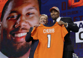 CAPTION: Commissioner Roger Goodell, left, poses with North Carolina State's Bradley Chubb after Chubb was selected by the Denver Broncos during the first round of the NFL football draft, Thursday, April 26, 2018, in Arlington, Texas.