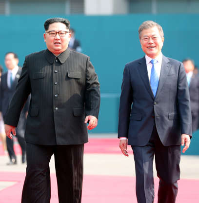 Slide 3 of 22: CAPTION: South Korean President Moon Jae-in and North Korean leader Kim Jong Un attend a welcome ceremony in the truce village of Panmunjom inside the demilitarized zone separating the two Koreas, South Korea, April 27, 2018. Korea Summit Press Pool/Pool via Reuters