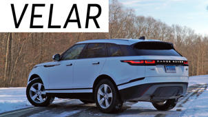 a car parked on the side of a road: 2018 Land Rover Range Rover Velar Road Test