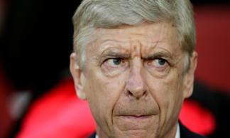 Arsenal's manager Arsene Wenger looks on prior to the Europa League semifinal first leg soccer match between Arsenal FC and Atletico Madrid at the Arsenal stadium in London, Britain, Thursday, April 26, 2018. (