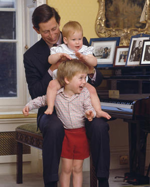 Slide 2 of 71: CAPTION: Prince Charles with his sons, Prince William and Prince Harry at Kensington Palace, London, 4th October 1985.(Photo by Tim Graham/Getty Images)
