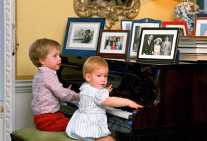 LONDON, UNITED KINGDOM - OCTOBER 04: Prince Harry And Prince William Playing The Piano Together At Home In Kensington Palace (Photo by Tim Graham/Getty Images)