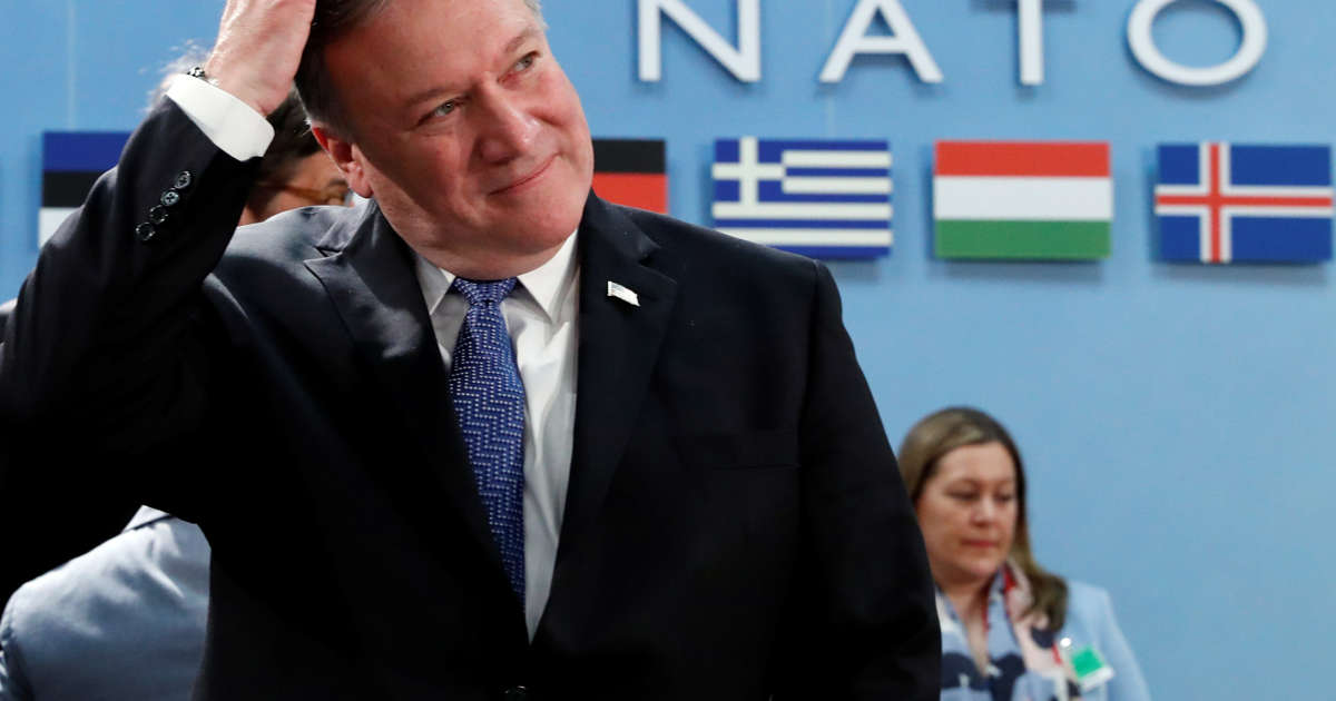 On first day, Pompeo charms NATO but warns on Iran, defense spending