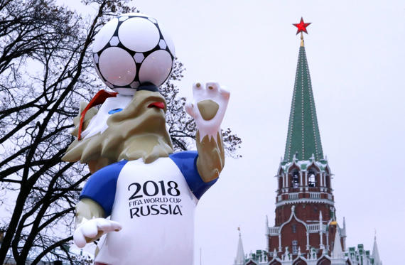 Slide 1 of 23: The official mascot for the 2018 FIFA World Cup Russia, Zabivaka, is on display near a tower of the Kremlin in central Moscow, Russia November 29, 2017. REUTERS/Sergei Karpukhin