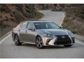 a car parked on the side of a road: 2016 Lexus GS