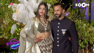 a man and a woman posing for a picture: B-town stars galore at Sonam-Anand's lavish reception