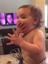 Watch this baby try on her mom's wedding ring and her reaction is epic