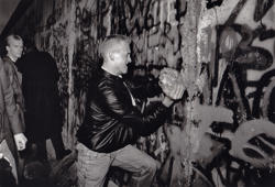November 11, 1989: A youth takes a large piece of the Berlin Wall in his hands as he tries to hammer a hole in the wall with it. Washington Post photo by Rich Lipski.