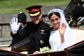 Prince Harry and Meghan Markle ride in an Ascot Landau after their wedding ceremony in St. George's Chapel at Windsor Castle.