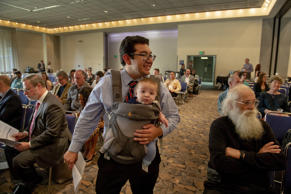 Sacramento councilman Eric Guerra carries his son Javier before addressing the Project Prosper Community Meeting at the Sacramento Convention Center on Thursday, April 26, 2018.