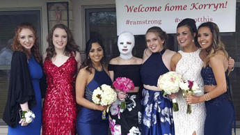 Korryn Bachner and her friends wear Prom dresses at Bachner's home on May 12, 2018.