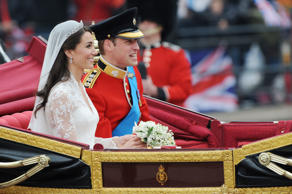 Prince William and Princess Catherine Elizabeth 'Kate' into the royal carriage returns to Buckingham Palace after their wedding at Westminster Abbey. (Photo by Stephane Cardinale/Corbis via Getty Images)