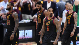 a group of basketball players: Cavaliers capitalize on Celtics' miscues in Game 4