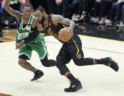 Cleveland Cavaliers' LeBron James drives on Boston Celtics' Terry Rozier in the first half of Game 4 of the NBA basketball Eastern Conference finals, Monday, May 21, 2018, in Cleveland.