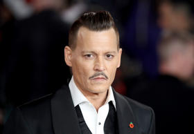 Johnny Depp plays LAPD detective Russell Poole.