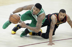 Boston Celtics' Marcus Smart, left, and Cleveland Cavaliers' George Hill go for a loose ball in the first half of Game 4 of the NBA basketball Eastern Conference finals, Monday, May 21, 2018, in Cleveland. (AP Photo/Tony Dejak)