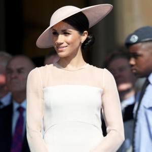 "Meghan Markle Just Wore Another Bridal Look, and All We Can Say Is, WOW: After having stunned in not one but two wedding dresses, Meghan Markle is already getting back to business. Two days after she said ""I do"" to Prince Harry, the former actress stepped out for her first royal engagement as the Duchess of Sussex. For the occasion, Meghan looked stunning in a peachy-pink Goat dress, which she accessorized with a bespoke Philip Treacy hat, nude pumps, and a Wilbur & Gussie clutch. To finish her gorgeous outfit, the duchess wore Vanessa Tugendhaft Idylle earrings and a diamond bracelet, which perfectly complemented her new wedding band. Of course, this incredibly elegant outfit is reminiscent of something Kate Middleton would wear - after all, Goat is one of the Duchess of Cambridge's go-to brands. However, this label isn't the only similarity between the new sisters-in-law. For this outing, Meghan also opted to carry a clutch and, perhaps most surprisingly, to wear tights, which are two of the rules that Kate always follows. Read on to get a closer look at Meghan's stunning dress, and then shop it for yourself. Related: Meghan Markle's Wedding and Reception Dress Sketches Are Just as Stunning as You'd Think"