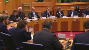 a group of people sitting at a table: Mark Zuckerberg tells EU 'sorry' for data leak
