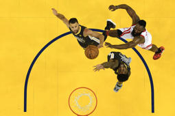 James Harden (13) of the Rockets takes a shot over Stephen Curry and Jordan Bell (2) of the Warriors during Game Four of the Western Conference Finals on May 22 in Oakland, California.