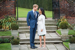 a person wearing a suit and tie walking on a sidewalk: Prince Harry Meghan Markle Engagement