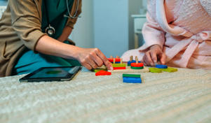 Doctor showing geometric shape game to patient with dementia