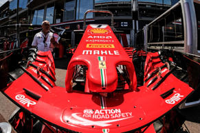 Technician inspect the Ferrari Formula One  stand at the Circuit de Monaco in Monte Carlo on May 23, 2018 ahead of the Monaco Formula One Grand Prix.