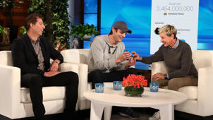a group of people sitting at a table: Ashton Kutcher Brings Ellen DeGeneres to Tears With Kind Surprise
