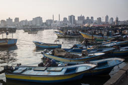 GAZA CITY, GAZA - JULY 22:  Gaza fishermen are seen returning to port after a nights work on July 22, 2017 in Gaza City, Gaza. Gaza's fishermen suffer under the blockade, and are only permitted to go as far as six nautical miles off the coast limiting their catch to small fish and crabs. For the past ten years Gaza residents have lived with constant power shortages, in recent years these cuts have worsened, with supply of regular power limited to four hours a day. On June 11, 2017 Israel announced a new round of cuts at the request of the Palestinian authorities and the decision was seen as an attempt by President Mahmoud Abbas to pressure Gaza's Hamas leadership. Prior to the new cuts Gaza received 150 megawatts per day, far below it's requirements of 450 megawatts. In April, Gaza's sole power station which supplied 60 megawatts shut down, after running out of fuel, the three lines from Egypt, which provided 27 megawatts are rarely operational, leaving Gaza reliant on the 125 megawatts supplied by Israel's power plant. The new cuts now restrict electricity to three hours a day severely effecting hospital patients with chronic conditions and babies on life support. During blackout hours residents use private generators, solar panels and battery operated light sources to live. June 2017 also marked ten years since Israel began a land, sea and air blockade over Gaza. Under the blockade, movement of people and goods is restricted and exports and imports of raw materials have been banned. The restrictions have virtually cut off access for Gaza's two million residents to the outside world and unemployment rates have skyrocketed forcing many people into poverty and leaving approximately 80% of the population dependent on humanitarian aid.  (Photo by Chris McGrath/Getty Images)