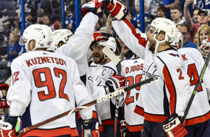 TAMPA, FL - MAY 23: Washington Capitals left wing Alex Ovechkin (8) and teammates celebrate after the seventh game of the NHL Stanley Cup Eastern Conference Final between the Washington Capitals and the Tampa Bay Lightning on May 23, 2018, at Amalie Arena in Tampa, FL. The Capitals defeated the Lightning 4-0 to win the series 4-3 and advance to the Stanley Cup Finals.