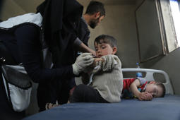 ALEPPO, SYRIA - APRIL 17 :  A Syrian child is vaccinated during the measles campaign in Al-Bab district of Aleppo, Syria on April 17, 2018. Kids fled from Eastern Ghouta's Douma after Assad regime forces' suspected chemical attack on April 7, 2018 receive measles vaccine Al-Bab district of Aleppo. (Photo by Omer Alven/Anadolu Agency/Getty Images)