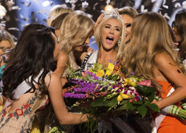 In this photo provided by The Miss Universe Organization, Sarah Rose Summers, Miss Nebraska USA 2018, is crowned Miss USA and congratulated by fellow contestants at the conclusion of the event, Monday, May 21, 2018, in Shreveport, La. (Brittany Elizabeth Strickland/The Miss Universe Organization via AP)