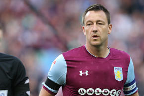 John Terry of Aston Villa wearing a black armband in tribute to Jlloyd Samuel during the Sky Bet Championship Play Off Semi Final:Second Leg match between Aston Villa and Middlesbrough at Villa Park on May 15, 2018 in Birmingham, England