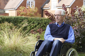 Senior man in a wheelchair outdoors