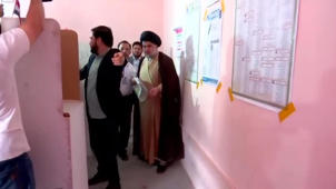 a man standing in a room: Iraqi Cleric al-Sadr Votes On Election Day