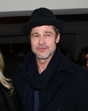 Brad Pitt wearing a hat: Brad Pitt attends the Cadillac Oscar Celebration in Los Angeles on March 1, 2018.