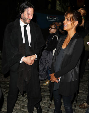 Slide 1 of 250: Keanu Reeves takes a break from filming the third installment of John Wick to chat with Halle Berry on the movie's N.Y.C. set.