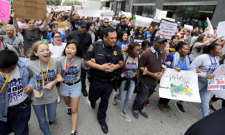 Houston Police Chief Art Acevedo, center, Houston Mayor Sylvester Turner, right, and Rep. Sheila Jackson Lee, D-Texas, right in blue, join demonstrators during a March for Our Lives protest for gun legislation and school safety Saturday, March 24, 2018, in Houston. Students and activists across the country planned events Saturday in conjunction with a Washington march spearheaded by teens from Marjory Stoneman Douglas High School in Parkland, Fla., where 17 people were killed in February.
