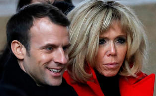 French President Emmanuel Macron and his wife Brigitte Macron - provided by REUTERS/Charles Platiau